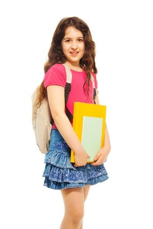 arab teen: Portrait of beautiful teenage girl with pile of books and backpack on white
