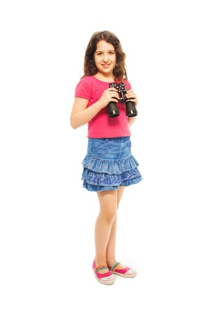 Nice girl holding binoculars and smiling, isolated on white - full height portrait photo
