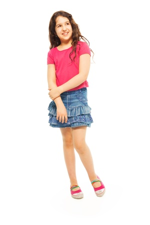11 years: Portrait of happy 11 years old girl with curly hair isolated on white - full height portrait