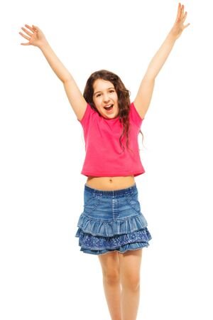 Portrait of happy 11 years old girl with lifted hands curly hair isolated on white - full height portrait photo