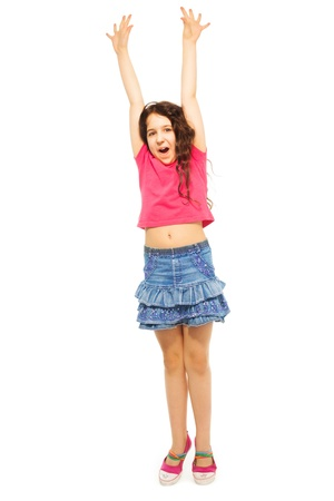 Portrait of happy 11 years old girl with lifted hands and screaming from joy, has curly hair, isolated on white - full height portrait photo
