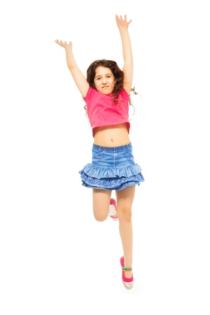 Portrait of happy 11 years old girl with curly hair jumping isolated on white - full height portrait photo
