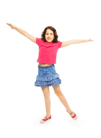 Portrait of happy 11 years old girl with curly hair jumping and lifting hands isolated on white - full height portrait photo