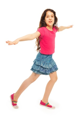 Portrait of happy 11 years old girl with curly hair, running, has ret hands lifted isolated on white - full height portrait photo