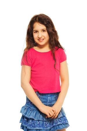 arab teen: Portrait of happy, smiling, shy 11 years old girl with curly hair, isolated on white Stock Photo