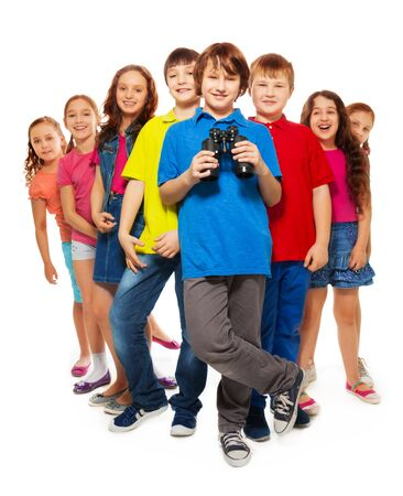 Large group of kids with confident happy boy holding binoculars Stock Photo - 18255200