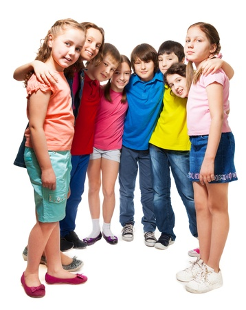Group of happy 10 years old boys and girls standing together in semi-circle Stock Photo - 18256671