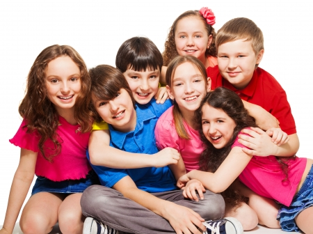 Group of 10 years old kids, boys and girls, hugging, smiling, laughing, on white photo