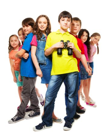 Big group of kids with confident boy holding binoculars Stock Photo - 18256139