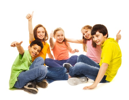 thumbs up group: Positive and happy kids sitting with thumb up gesture together, smiling, laughing