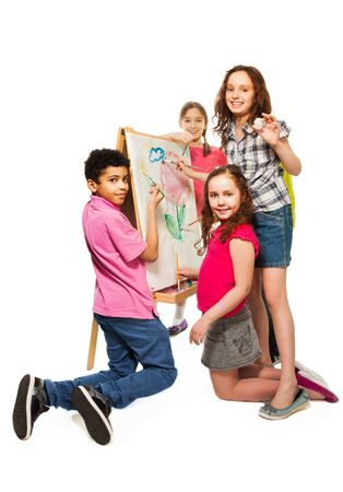 Group of four kids, boys and girls painting image together with paintbrushes on the white canvas Stock Photo - 18256369