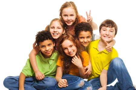 Group of happy, 10 years old boys and girls smiling, gesticulating and hugging