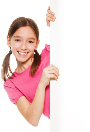 ponytails: Close-up of beautiful girl with ponytails looking from white placard, isolated on white