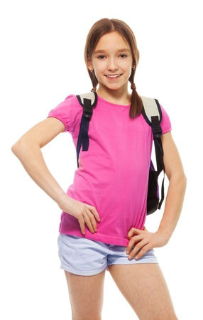 Portrait of cute, smiling, confident 9 years old girl with ponytails, wearing backpack isolated on white, photo
