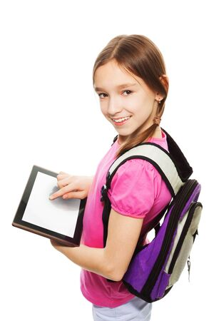 Smart Caucasian 9 years old girl showing new application on digital tablet computer, standing isolated on white Stock Photo