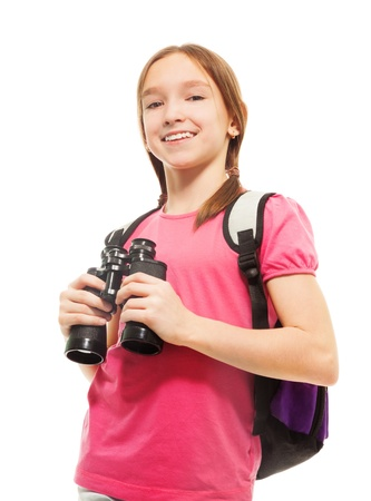 Beautiful teen girl holding binoculars isolated on white, side view, waist up portrait with big smile Stock Photo - 18256031