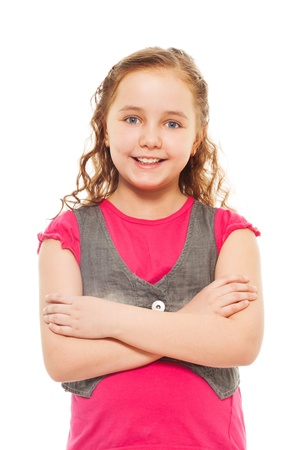 Portrait of happy, smiling, confident 9 years old girl with curly hair, isolated on white photo