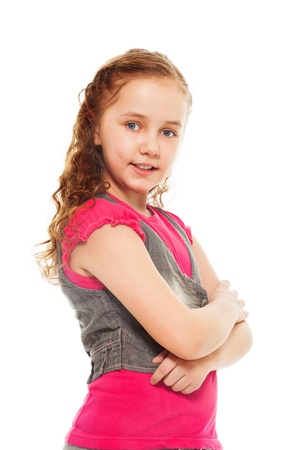 Portrait of happy, smiling, confident 9 years old girl with curly hair, isolated on white - side view photo
