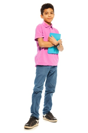 Cute 10 years old black boy standing with tablet computer, full height, isolated on white photo