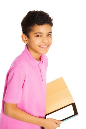 10 years old: Happy and smiling 10 years old black boy standing with tablet computer, isolated on whtie Stock Photo