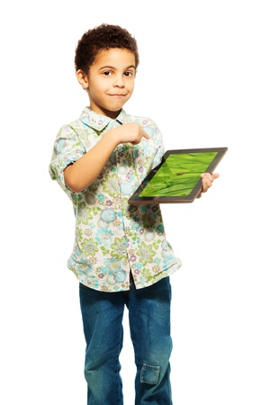five years old: Black boy shows photograph on tablet computer pointing with finger (image from photographers portfolio)