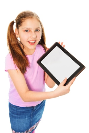 11 years: Happy and smiling Caucasian 11 years old girl showing content of tablet computer, isolated on white