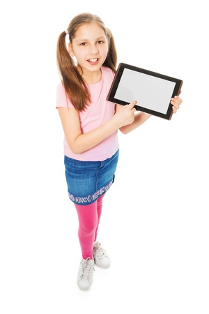 11: Happy and smiling Caucasian 11 years old girl showing content of tablet computer, isolated on white, full length portrait