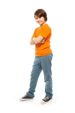 Cute 11 years old very confident boy isolated on white, full height portrait photo
