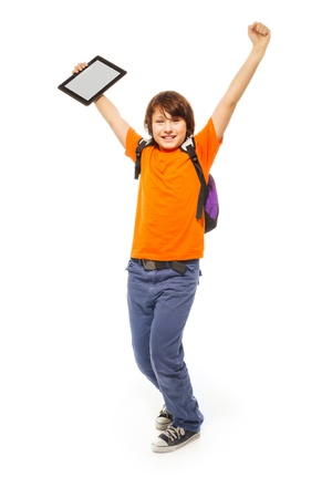 11 years: Happy and surprised Caucasian 11 years old girl with tablet computer, isolated on white