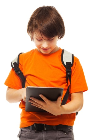 occupied: Smart Caucasian boy occupied with digital tablet computer, standing isolated on white Stock Photo
