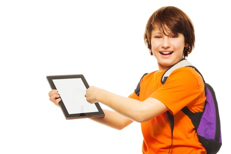 11 years: Smart Caucasian 11 years old boy showing new application on digital tablet computer, standing isolated on white Stock Photo