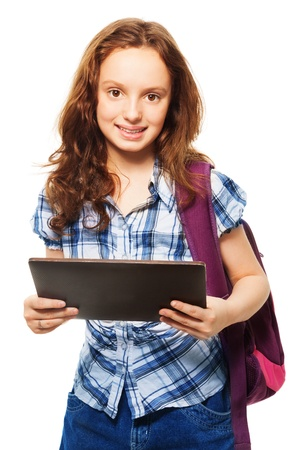 occupied: Smart Caucasian girl occupied with digital tablet computer, standing isolated on white