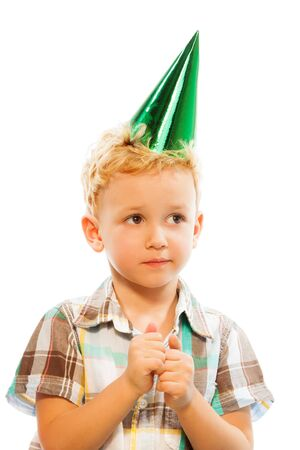 anticipating: Blond boy anticipating his birthday, portrait isolated on white