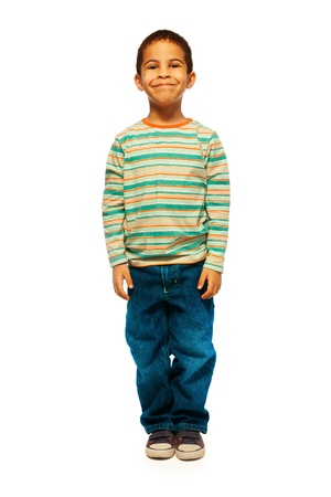 full height: Full height portrait of cute black boy with smile on face standing isolated on white