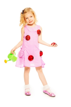 five years old: Little five years old blond girl with watering can and red ladybugs standing isolated on white Stock Photo