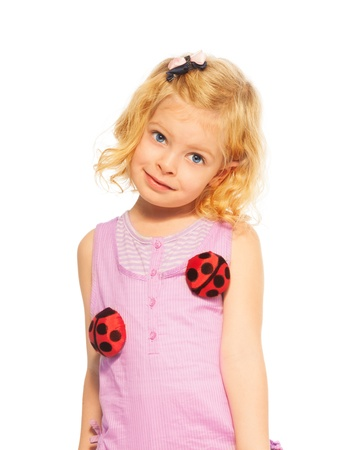Little shy girl with curly hair and lady bugs on her dress photo