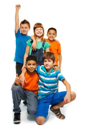 Group of happy smiling kids standing together - boys and girls black and Caucasian photo