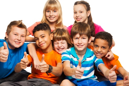 children party: Group of boys and girls Caucasian and black showing thumb up