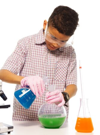 Clever boy exerimenting in the lab with flasks and chimistry photo