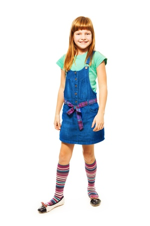 full height: 8 years old Caucasian girl with long hair standing isolated on white full height portrait