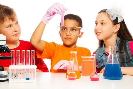 science experiments: Boys and girls learning chemistry and conduct experiments Stock Photo