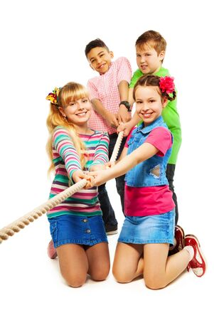 Group of five diversity looking kids pulling the rope together as a team, isolated on white Stock Photo - 18420771