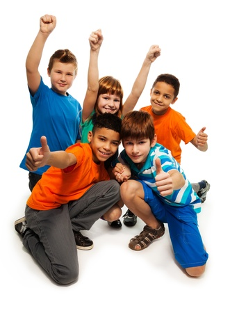 child looking up: Group of happy smiling kids standing together and playing - boys and girls black and Caucasian