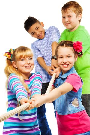 Close-up of group of five diversity looking kids pulling the rope together as a team, isolated on white Stock Photo - 18420976