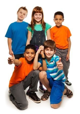 long hair boy: Group of happy smiling kids standing together and playing - boys and girls black and Caucasian, isolated on white