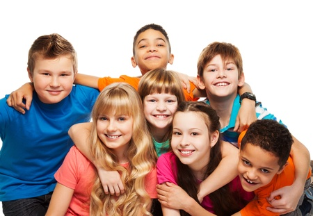 Large group of kids age 8-11 hugging, smiling and laughing, boys and girls