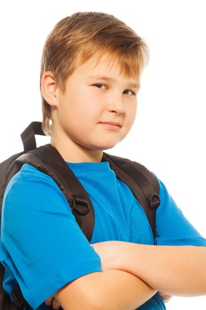 cool kids: Confident schoolboy with backpack smiling looking at camera