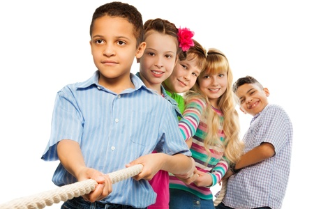 Boys and girls pull ther rope together working as a team Stock Photo - 18420806