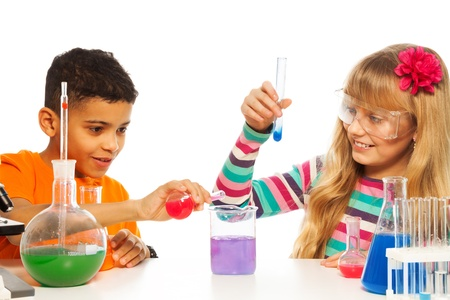 science lesson: Kids experimenting with chemistry in the school chemistry laboratory class