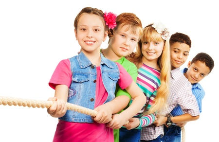 Girls and boys pull the rope together as a team isolated on white Stock Photo - 18420635